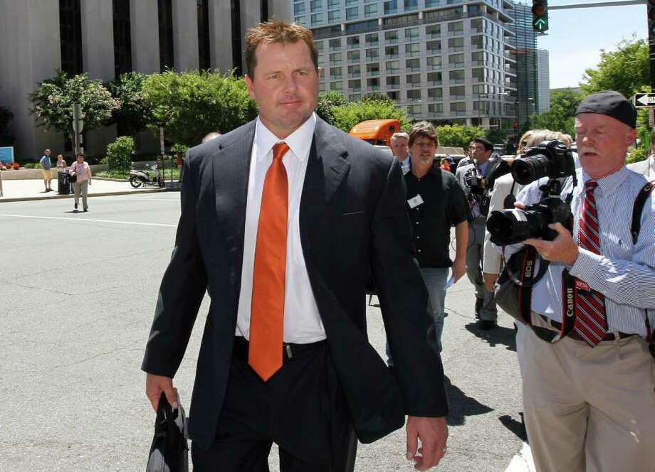 Former Major League baseball pitcher Roger Clemens walks from federal court in Washington, Thursday, July 14, 2011, after the judge declared a mistrial in his perjury trial after prosecutors showed jurors evidence that the judge had ruled out of bounds.  (AP Photo/Alex Brandon) Photo: Alex Brandon, ASSOCIATED PRESS / AP2011