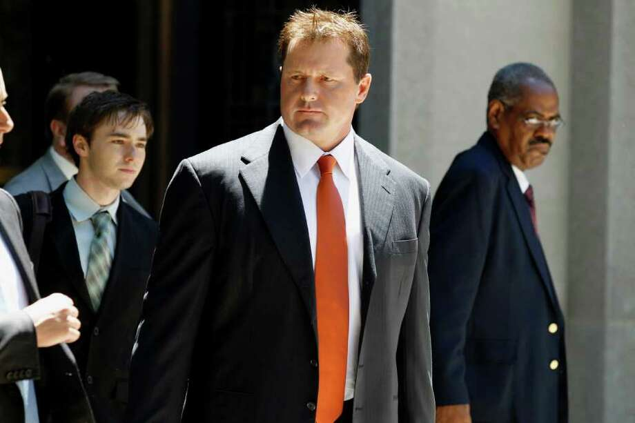 Former Major League baseball pitcher Roger Clemens leaves federal court in Washington, Thursday, July 14, 2011, after the judge declared a mistrial in his perjury trial after prosecutors showed jurors evidence that the judge had ruled out of bounds.  (AP Photo/Alex Brandon) Photo: Alex Brandon, ASSOCIATED PRESS / AP2011