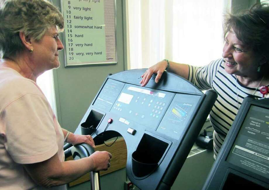 SPECTRUM/Rehab patient Tillie Jellen is given instruction on a machine in the rehabilitation center at New Milford Hospital by RN Wendy Kosier. Photo: Norm Cummings