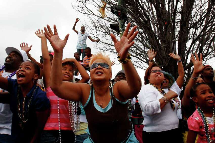 Spectators beg for throws during the Zulu Parade on Mardi Gras day, Tuesday, Feb. 5 2008. The parade returned to its original route for the first time since Hurricane Katrina. (Nicole Fruge/San Antonio Express News)