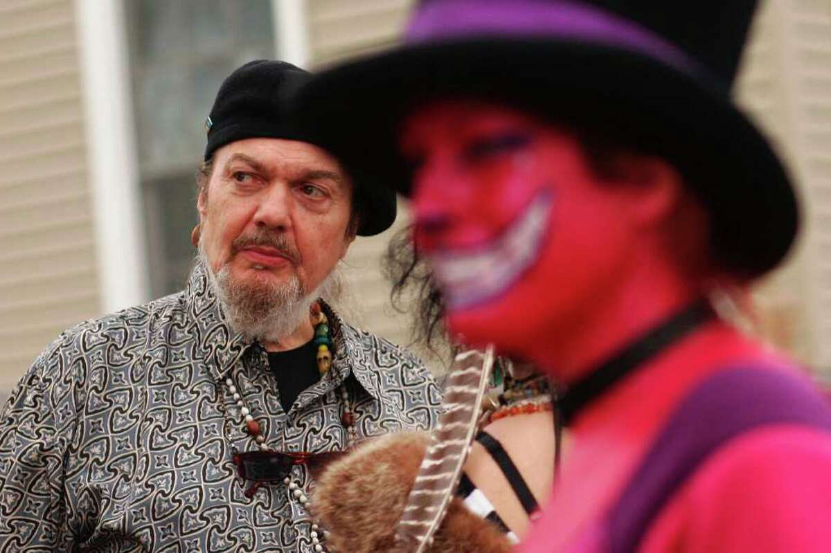 Music legend Dr. John waits for the Yellow Pocahontas second chief David Montana to unveil his Mardi Gras Indian costume in the Treme neighborhood on Mardi Gras day, Tuesday, Feb. 5 2008. (Nicole Fruge/San Antonio Express News)