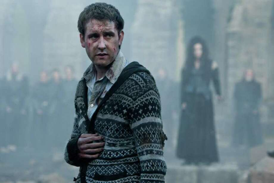 """Matthew Lewis, better known as """"Harry Potter's"""" Neville Longbottom, is ultra-embarrassed by his mom's display of collectibles from the film. """"My mum thinks it's cute and shows it to anyone who comes to visit."""" If we'd had the chance to appear in eight blockbuster films, we'd let our moms get Harry Potter face tattoos. Just sayin'.  Photo: Jaap Buitendijk, Photographer / (C) 2011 WARNER BROS. ENTERTAINMENT INC. HARRY POTTER PUBLISHING RIGHTS (C) J.K.R. HARRY POTTER CHARACTERS, NAMES AND RELATED IN"""