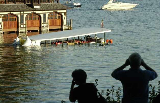 People watch from the bank of Lake George on Oct. 3, 2005, as the tour ship Ethan Allen is raised from 70 feet below surface of the lake after capsizing, killing tour passengers. (Times Union archive) Photo: SKIP DICKSTEIN / ALBANY TIMES UNION
