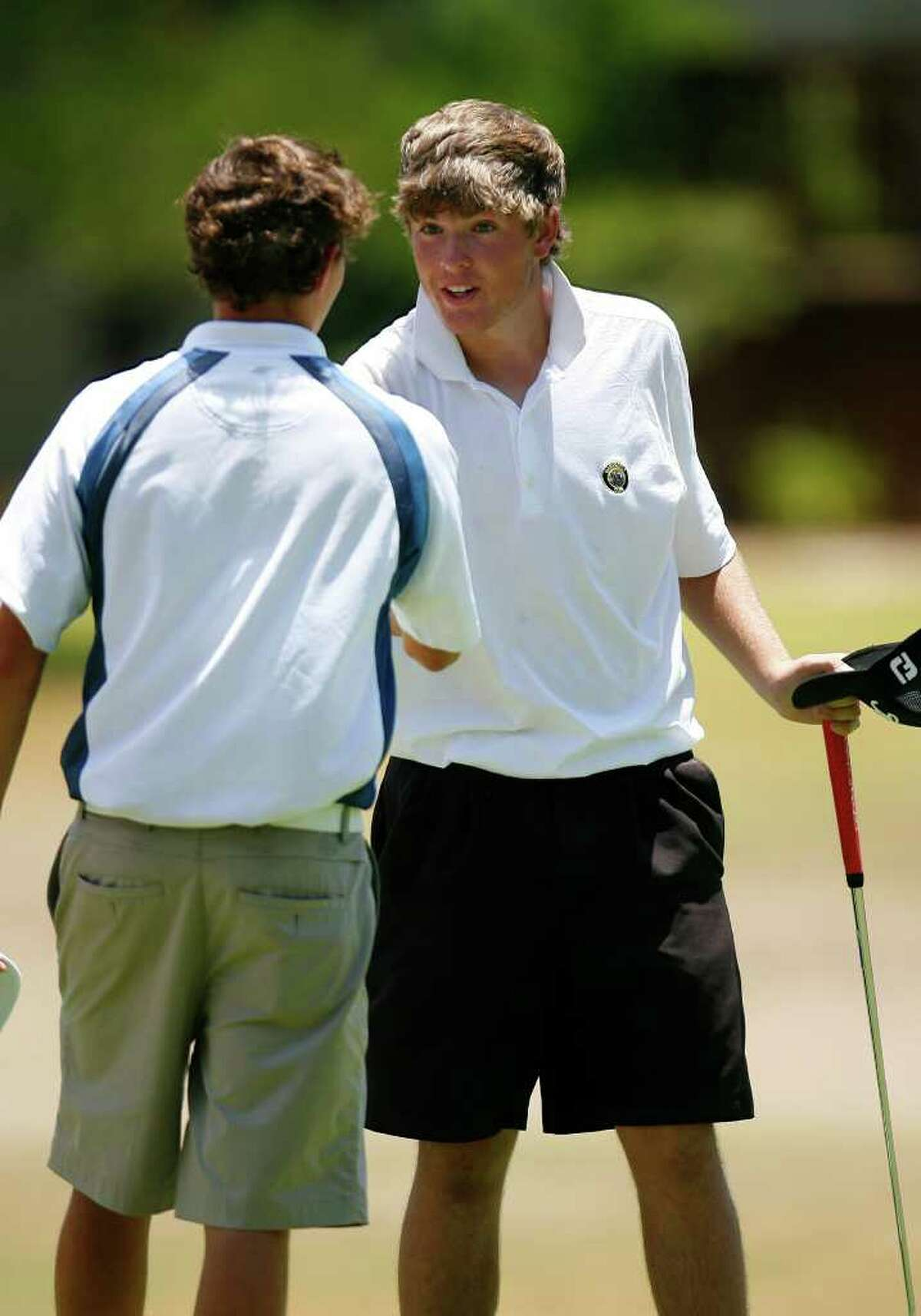 Matt Gilchrest, left, shakes hands with Brandon Pierce after the final round of the Genesis Shootout Thursday, July 24, 2011 at the Fair Oaks Ranch Country Club. Kayli Quinton of Houston won the girls division andGilchrest took the boys division. SALLY FINNERAN/sfinneran@express-news.net