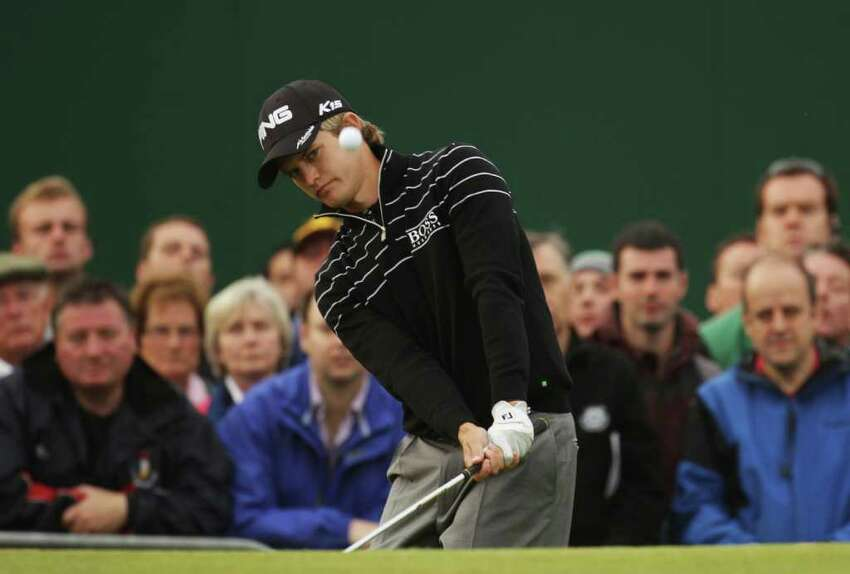 SANDWICH, ENGLAND - JULY 14: Tom Lewis of England chips onto the 18th green during the first round of The 140th Open Championship at Royal St George's on July 14, 2011 in Sandwich, England. (Photo by Ross Kinnaird/Getty Images)