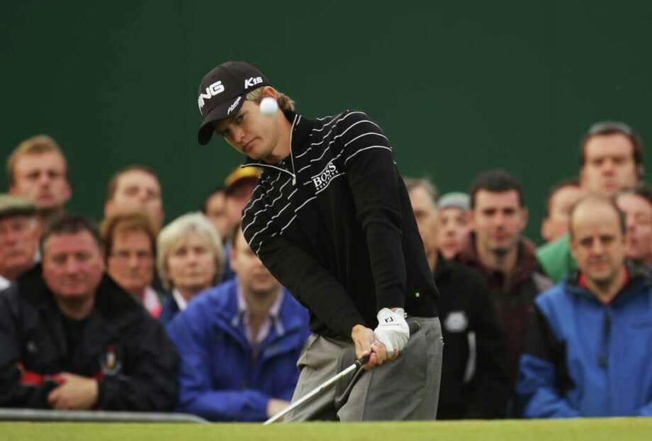 SANDWICH, ENGLAND - JULY 14:  Tom Lewis of England chips onto the 18th green during the first round of The 140th Open Championship at Royal St George's on July 14, 2011 in Sandwich, England.  (Photo by Ross Kinnaird/Getty Images) Photo: Ross Kinnaird, Getty / 2011 Getty Images