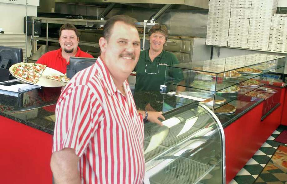 Salís Pizza owner Sal Sproviero, forground, and partners Adam Ross, left and Bruce Ross, right at their new store at Dolan Plaza on Greenwood Avenue in Bethel. Photo: John Pirro
