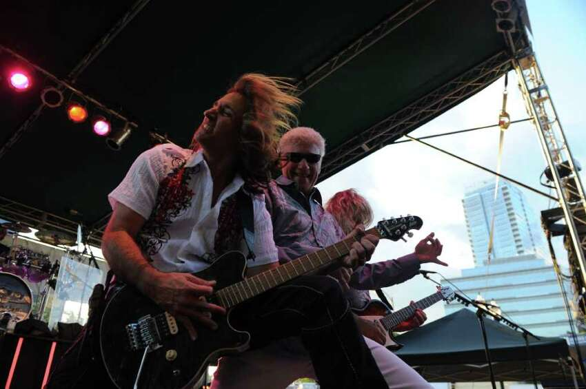 Dennis DeYoung, center, rocks Columbus Park with the music of Styx during Alive@Five in Stamford, Conn., July 14, 2011. Jerry Pia & SlikStuf and Fighting the Influence also played. Pia is Vice President of the Board of Education and Chair of the Republican Town Committee.