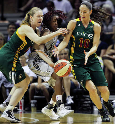 Storm guards Katie Smith (left) and Sue Bird combine to squeeze the ball away from Danielle Robinson as the San Antonio Silver Stars play the Seattle Storm at the AT&T Center on July 14, 2011.    Tom Reel/Staff / © 2011 San Antonio Express-News