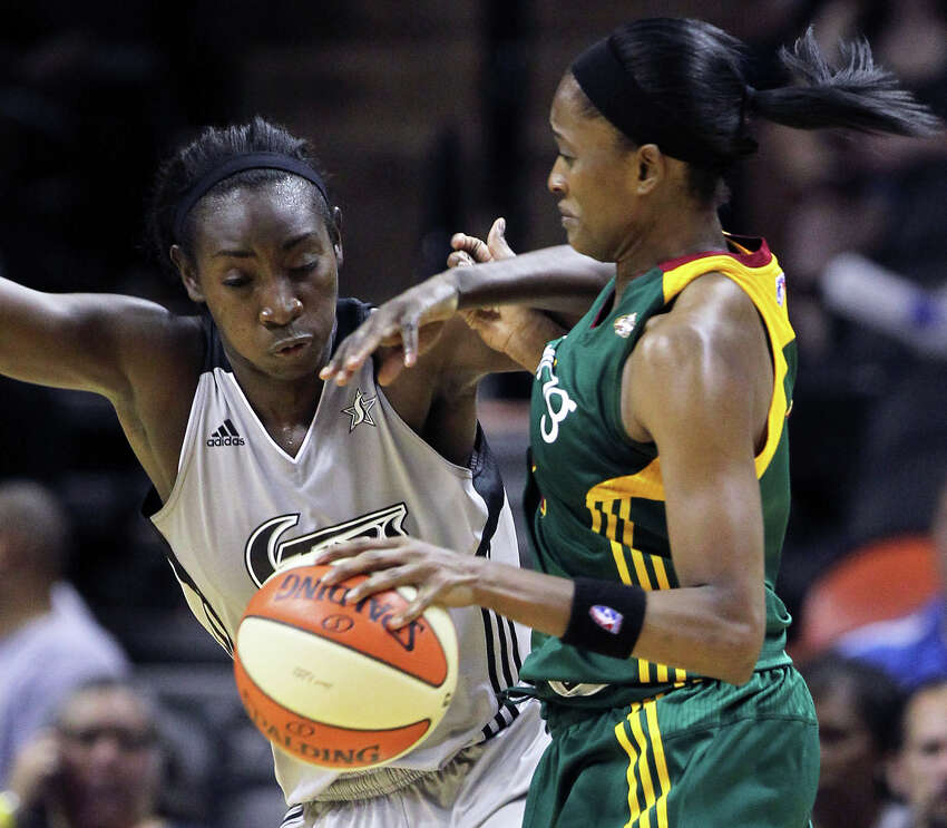 San Antonio's Sophia Young takes a shot at a steal against Swin Cash as the San Antonio Silver Stars play the Seattle Storm at the AT&T Center on July 14, 2011. Tom Reel/Staff