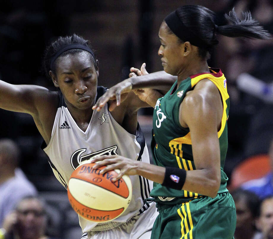 San Antonio's Sophia Young takes  a shot at a steal against Swin Cash as the San Antonio Silver Stars play the Seattle Storm at the AT&T Center on July 14, 2011.    Tom Reel/Staff / © 2011 San Antonio Express-News