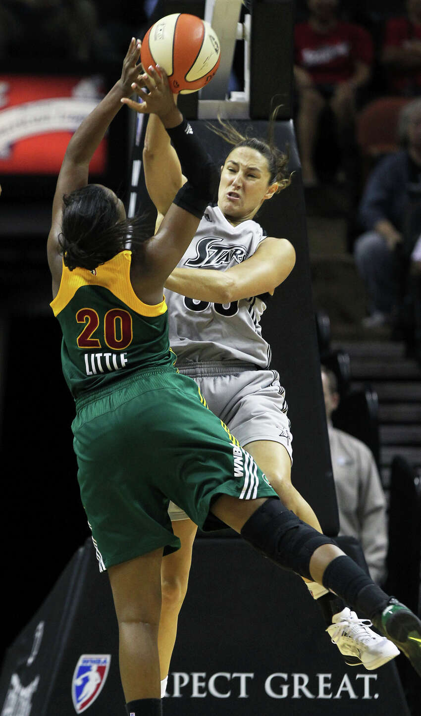 San Antonio's Ruth Riley rejects a shot by Camille Little in the first half as the San Antonio Silver Stars play the Seattle Storm at the AT&T Center on July 14, 2011. Tom Reel/Staff