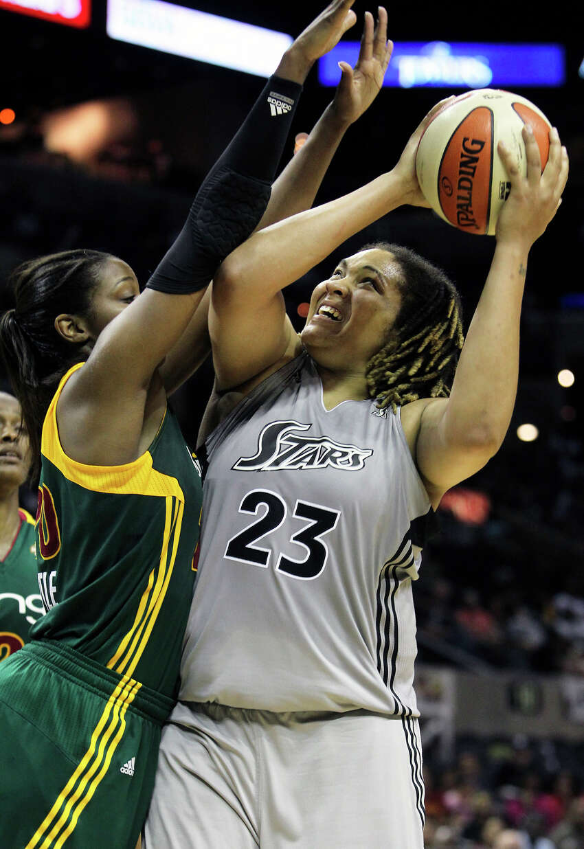 Stars forward Danielle Adams gets tough points in the final minutes against Camille Little as the San Antonio Silver Stars play the Seattle Storm at the AT&T Center on July 14, 2011. Tom Reel/Staff