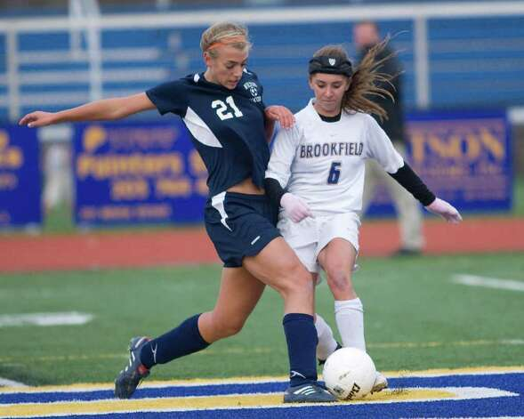 Brookfield's Tia Weise (6) and Wilton's Brynn Hansson battle for control of the ball during their first round Class L state tournament match Tuesday at Brookfield High. Photo: Barry Horn