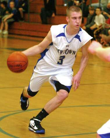 Newtown's Andy Lapple, 3, heads up court during the basketball game against, Newington at Newtown High Tuesday, March 9, 2010. Photo: Chris Ware