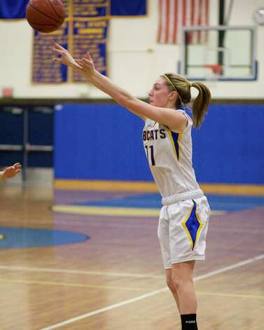 Brookfield's Julia DePoi puts up a three-point shot against Northwest Catholic in the Bobcats' Class L state tournament first round game Monday night at Brookfield High School. Photo: Barry Horn