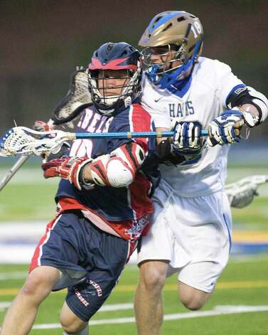 Newtown's Brendan McNamara, right, plays tight defense against New Fairfield's Robbie Fiamengo Friday night at Newtown High School. Photo: Barry Horn