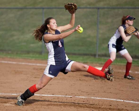 New Fairfield's Cynthia Barata fires a pitch against Bethel Monday at New Fairfield High School. Photo: Barry Horn