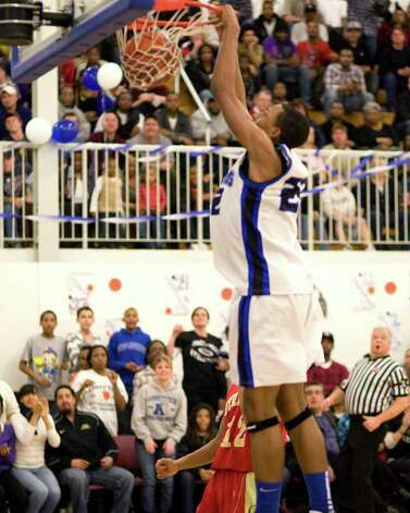 Abbott Tech's Anthony Henry dunks against Stratford Monday night at Abbott Tech High. Photo: Barry Horn