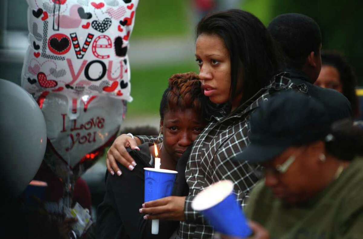Mourners gather during a memorial for Tanaya Gilbert, a 19 year-old woman shot and killed in South Seattle. A memorial was held for the woman, who was pregnant. The vigil was later marred by another shooting.
