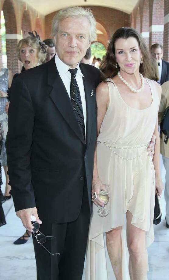 Saratoga Springs, NY - July 9, 2011 - (Photo by Joe Putrock/Special to the Times Union) - New York City Ballet Master in Chief Peter Martins(left) and his wife Darci Kistler(right) enter the 2011 Ballet Gala: A Gatsby Evening, a fundraiser for New York City Ballet's engagement at SPAC. Photo: Joe Putrock / Joe Putrock