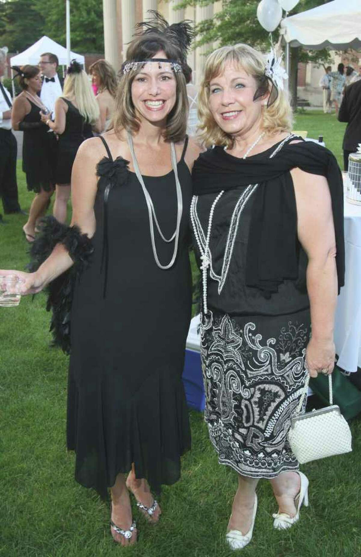 Saratoga Springs, NY - July 9, 2011 - (Photo by Joe Putrock/Special to the Times Union) - Tamie Ehinger(left) poses with Ivy Brockley(right), who was wearing her grandmother's 1929 vintage dress, during the SPAC Gala Lawn Party: A Gatsby Evening, hosted by SPAC's Junior Committee.