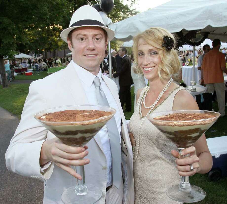 Saratoga Springs, NY - July 9, 2011 - (Photo by Joe Putrock/Special to the Times Union) - Seth(left) and Sequoyah(right) Finkell get ready for dessert with their martini glass tiramisus during the SPAC Gala Lawn Party: A Gatsby Evening, hosted by SPAC's Junior Committee. Photo: Joe Putrock / Joe Putrock