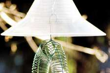 Finch 0716 Baffle  The Mandarin Squirrel Away Baffle hangs above feeders to keep squirrels away. Suggested retail, $24.99 at Wild Birds Unlimited.  Credit: Courtesy Wild Birds Unlimited