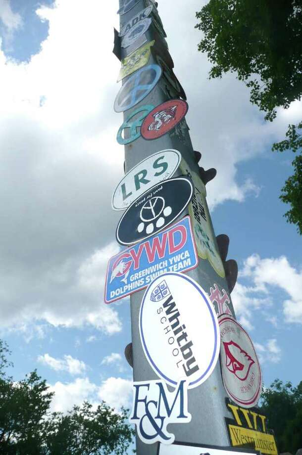 The lamp post in front of the Old Greenwich Car Wash has become a impromptu display space for lost car magnets that have come off during the washing process. It has a certain artsy look to it. Photo: Anne W. Semmes