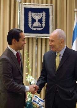 *** SPECIAL FOR THE SAN ANTONIO EXPRESS-NEWS *** San Antonio, Texas Mayor Julian Castro, left, shakes hand with Israel's President Shimon Peres at Peres' residence in Jerusalem, Thursday, July 14. 2011. Photo: Dan Balilty, AP / AP