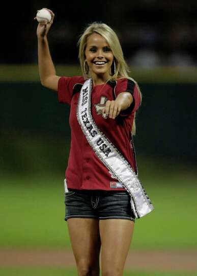 Brooke Daniels, former Miss Harris County and current Miss Texas USA, throws the first pitch before