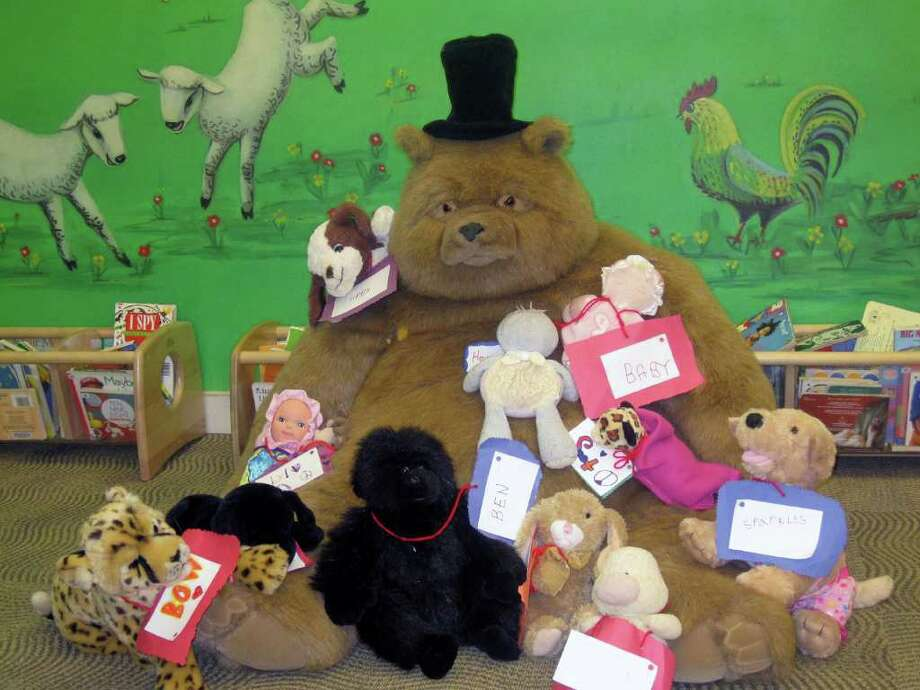"""Stuffed animals left at the Fairfield Public Library for a """"sleepover"""" got into some mischief once everyone went home for the night. Photo: Contributed Photo / Fairfield Citizen"""