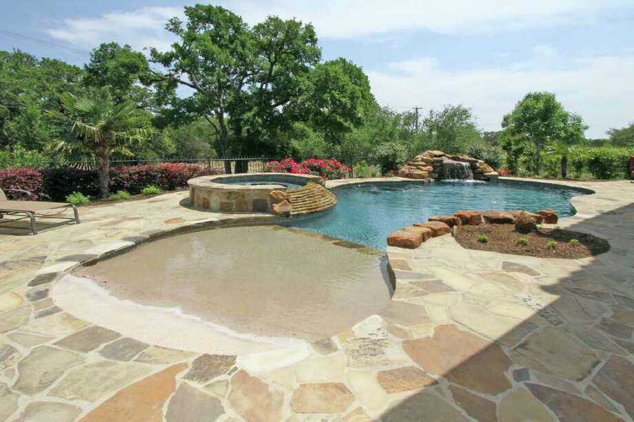 Investing in a pool san antonio express news for Pool design beach entry