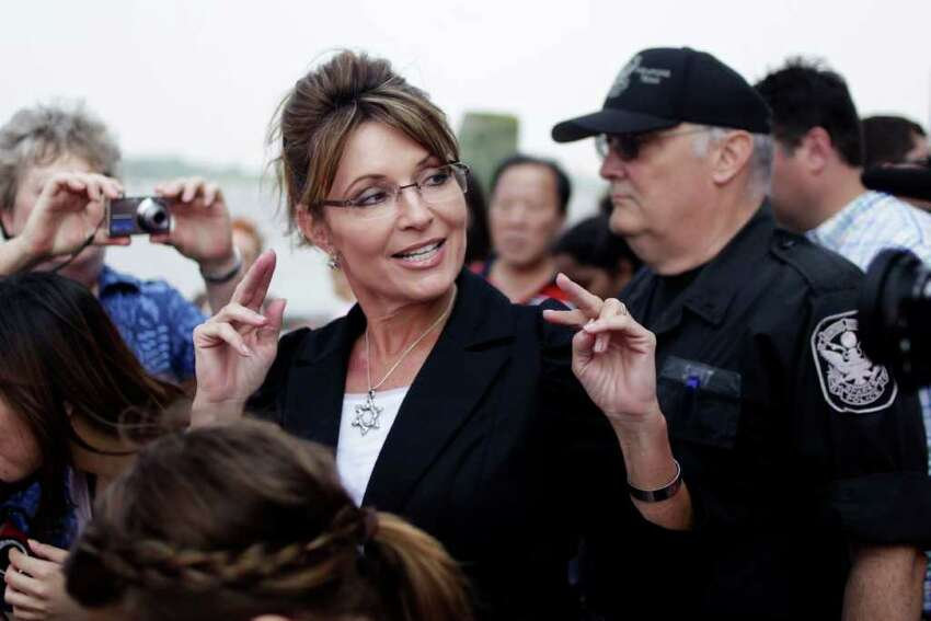 FILE - In this June 1, 2011 file photo, former Alaska Gov. Sarah Palin talks to the media as she leaves Liberty Island in New York. Palin will visit Iowa, Tuesday, June 28, to attend the premiere of a documentary about her time as governor and her ascent as a national political figure. (AP Photo/Seth Wenig, File)