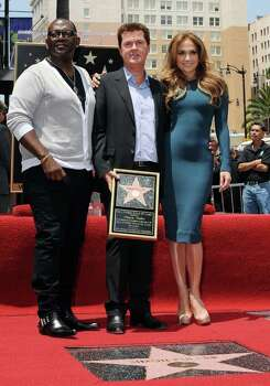 Randy Jackson (L) and singer/actress Jennifer Lopez, stand beside producer Simon Fuller (C) after he unveilled it at the ceremony honoring him with a Hollywood Walk of Fame star, held in Hollywood, California on May 23, 2011        AFP PHOTO/Mark RALSTON (Photo credit should read MARK RALSTON/AFP/Getty Images) Photo: MARK RALSTON, Staff / AFP