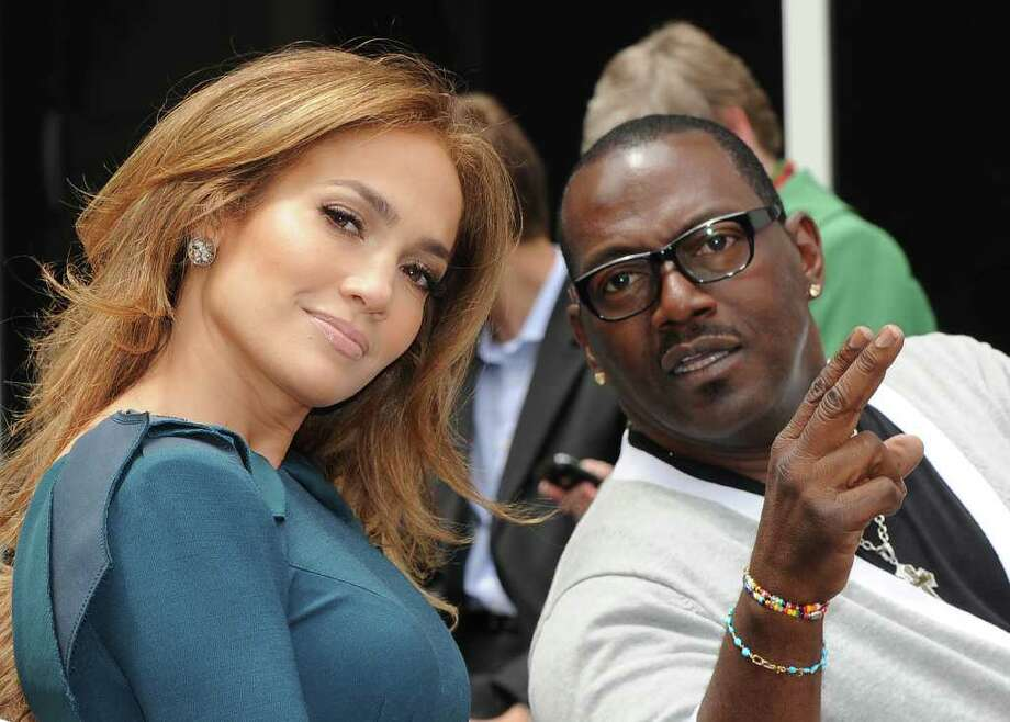 Singer/actress Jennifer Lopez and Randy Jackson, look on as producer Simon Fuller unveils his star at the ceremony honoring him with a Hollywood Walk of Fame star, held in Hollywood, California on May 23, 2011        AFP PHOTO/Mark RALSTON (Photo credit should read MARK RALSTON/AFP/Getty Images) Photo: MARK RALSTON, Staff / AFP