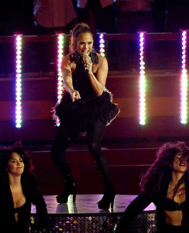 "U.S. singer and actress Jennifer Lopez performs  during the German television show 'Wetten, dass..?' at the ""Coliseo Balear"" bull fighting arena in Palma de Mallorca on the Balearic Island of Mallorca, Spain, Saturday,  June 18, 2011.  (AP Photo/Jaime Reina, pool) Photo: JAIME REINA, POOL / POOL AFP"