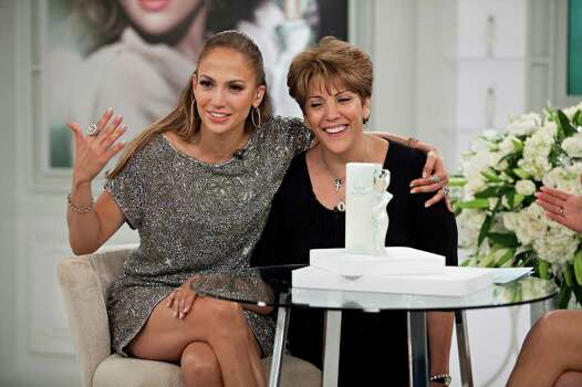 "In this image released by HSN, Jennifer Lopez shares a moment with her mother, Lupe, during a live appearance for the debut of her new fragrance ""Love and Light"" in St. Petersburg, Fla., on Saturday, July 2, 2011.  (AP Photo/HSN, Jason Henry) Photo: Jason Henry, HOEP / HSN"