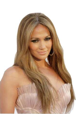 "FILE - Jennifer Lopez arrives for the amfAR Cinema Against AIDS benefit at the Hotel du Cap-Eden-Roc, during the 63rd Cannes international film festival, in Cap d'Antibes, southern France in this May 20, 2010 file photo. Lopez is close to signing a deal to join Fox TV's ""American Idol"" as a judge, a person familiar with the negotiations said late Thursday July 29, 2010. The person, who was not authorized to comment publicly, spoke on condition of anonymity.  (AP Photo/Joel Ryan, File) Photo: Joel Ryan"