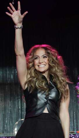 "In this image released by Hard Rock International, Jennifer Lopez waves to the crowd during her ""LOVE?"" album launch event at Hard Rock Cafe Hollywood, Tuesday, May 3, 2011, in Los Angeles. (AP Photo/Hard Rock International/Rene Macura) Photo: Rene Macura, HONS"