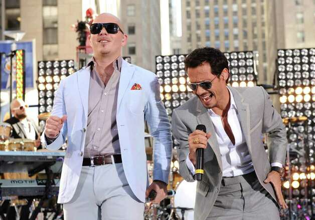 "In this July 1, 2011 publicity photo released by NBC, singers Pitbull, left, and Marc Anthony perform on the ""Today"" show on Friday, July 1, 2011 in New York. (AP Photo/NBC, Peter Kramer) Photo: Peter Kramer, HOEP / © NBCUniversal, Inc."