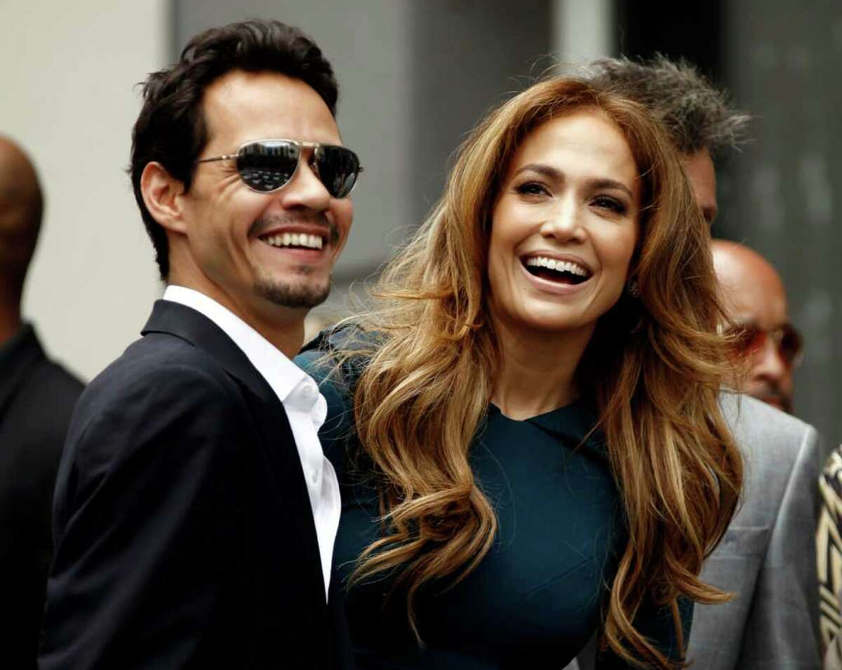 """Jennifer Lopez, right, and her husband Marc Anthony laugh before a Hollywood Walk of Fame star ceremony for entertainment producer Simon Fuller in Los Angeles, Monday, May 23, 2011. Fuller is the creator of """"American Idol""""."""