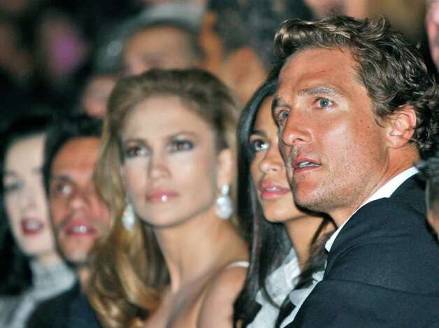 Actor Matthew McConaughey, right, and actress and singer Jennifer Lopez, third from left, attend the Dolce & Gabbana women's Spring/Summer 2009 fashion collection presented in Milan, Italy, Thursday, Sept. 25,  2008. Second from left is Lopez's husband Marc Anthony. Photo: LUCA BRUNO, AP / AP