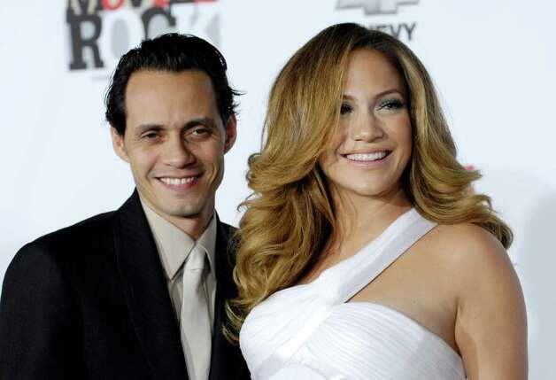 "Marc Anthony and his wife Jennifer Lopez pose together at ""Movies Rock: A Celebration of Music in Film,""  in Los Angeles, in this Dec. 2, 2007, file photo. Lopez and Anthony have named their newborn twins Max and Emme, People magazine reported Friday Feb. 29, 2008. Photo: Chris Pizzello, AP / A-PIZZELLO"