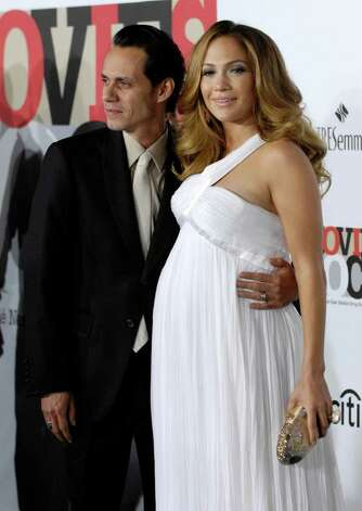 "Marc Anthony and his wife Jennifer Lopez pose together at ""Movies Rock: A Celebration of Music in Film,""  in Los Angeles, in this Dec. 2, 2007, file photo. Photo: Chris Pizzello, AP / A-PIZZELLO"