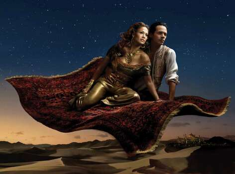 "In this photo illustration released by Disney Parks, singers Jennifer Lopez, portrayed as Jasmine and husband Marc Anthony as Aladdin from Disney's ""Aladdin,"" soar through the Arabian night in part two of a dream scene entitled ""Where a Whole New World Awaits,"" created by photographer Annie Leibovitz. This Leibovitz image unveiled Thursday, Jan. 24, 2008, was created for the ""Disney Dream Portrait Series"" to celebrate Disney Parks' ""Year of a Million Dreams.""  Disneyland Resort in California and Walt Disney World Resort in Florida commissioned Leibovitz to create images featuring international celebrities in fairy tale settings. Photo: Annie Leibovitz, AP / Disney Parks"