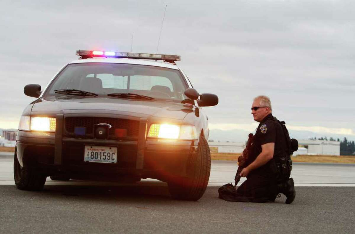 A policeman takes position during a training exercise at Sea-Tac International Airport.
