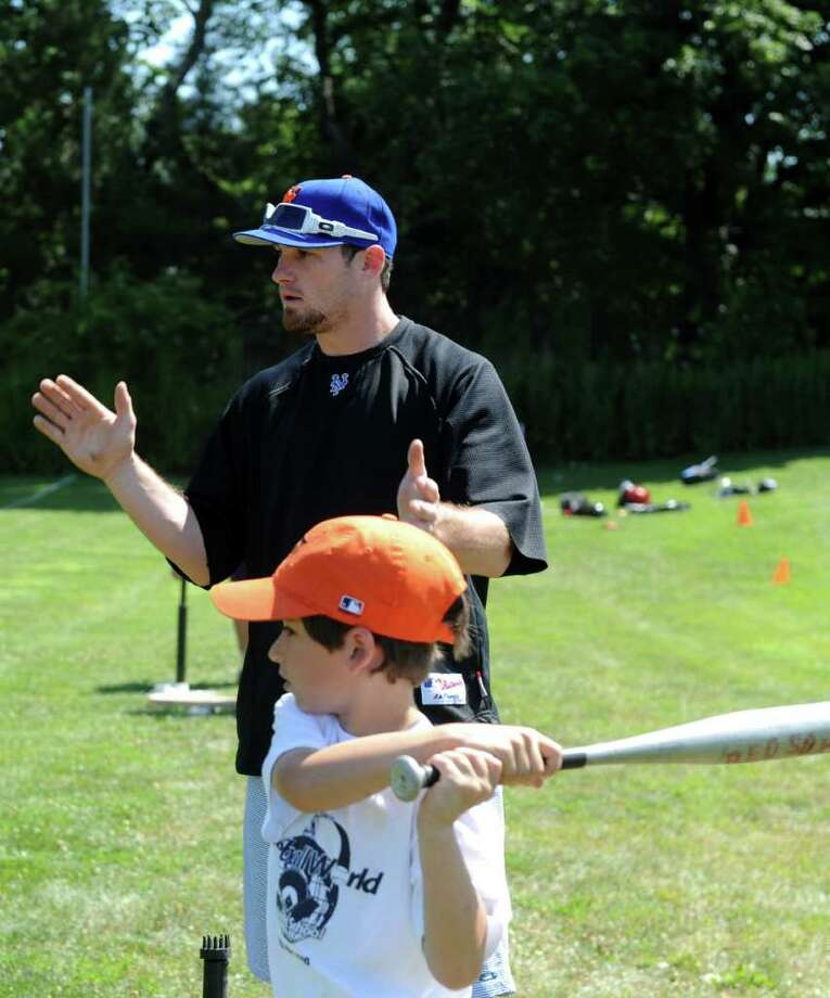 New York Mets players Daniel Murphy and Nick Evans train the next generation of sluggers Friday, July 15, 2011 at Baseball World Training School in Westport, Conn. Photo: Autumn Driscoll / Connecticut Post
