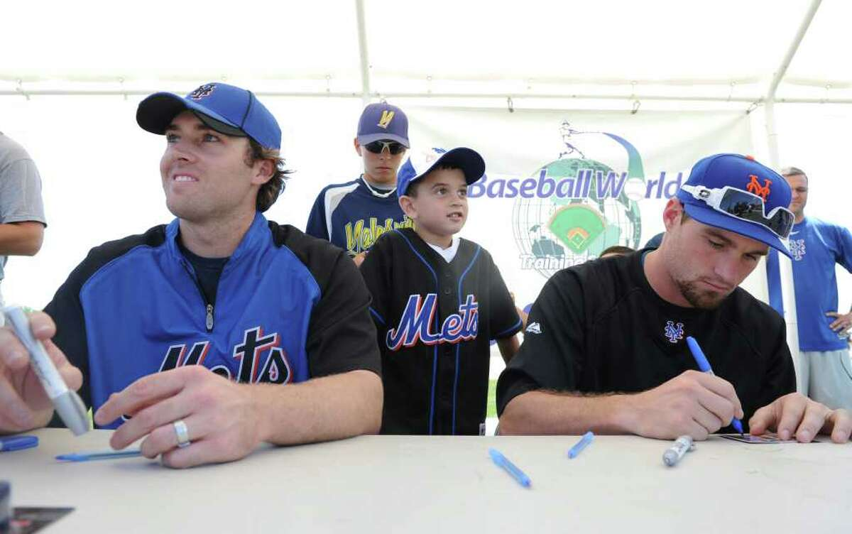 New York Mets players Daniel Murphy and Nick Evans train the next generation of sluggers Friday, July 15, 2011 at Baseball World Training School in Westport, Conn.
