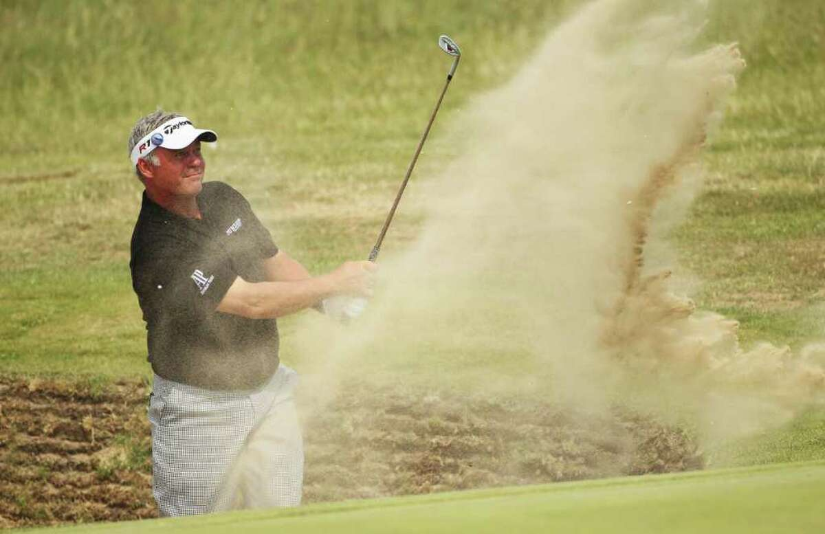 SANDWICH, ENGLAND - JULY 15: Darren Clarke of Northern Ireland hits from a bunker on the 16th hole during the second round of The 140th Open Championship at Royal St George's on July 15, 2011 in Sandwich, England. (Photo by Andrew Redington/Getty Images)